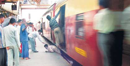 he slipped and fell in the gap between the train and the platform at Kandivli station